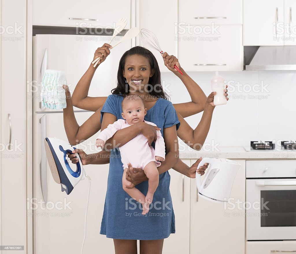 Housework with baby. stock photo