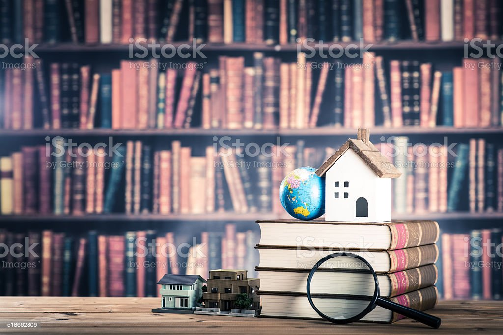 Housing and knowledge stock photo