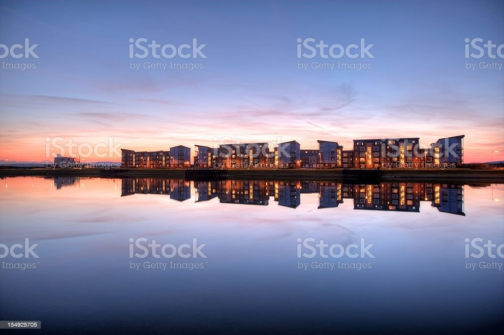 Housing development and reflection at sunset royalty-free stock photo