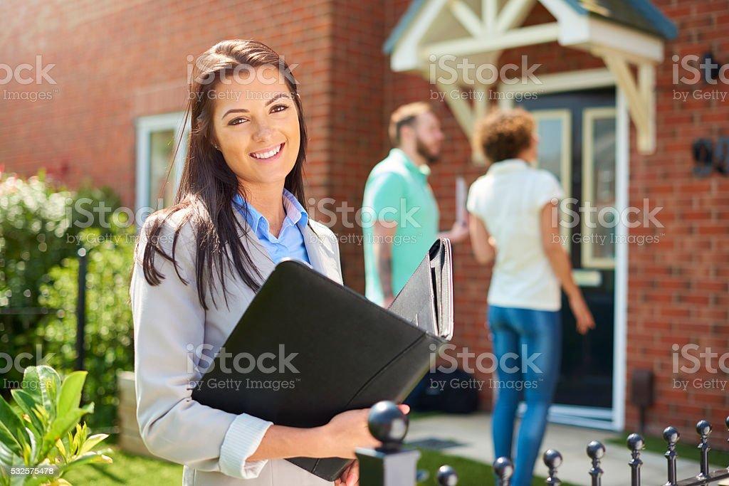 housing development saleswoman stock photo