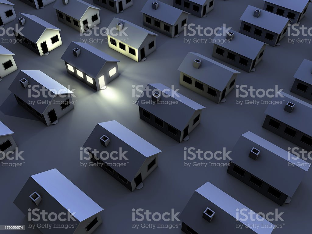 housing estate in the night, one house with light stock photo