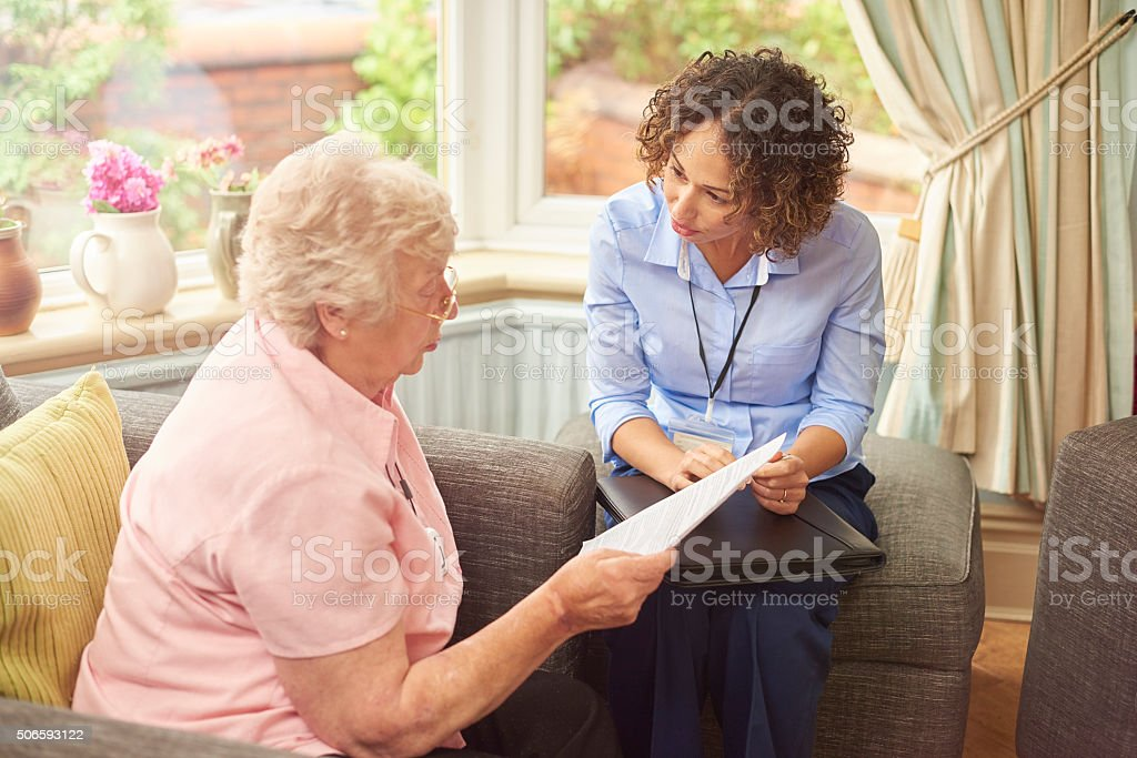 housing officer listens to tenant stock photo