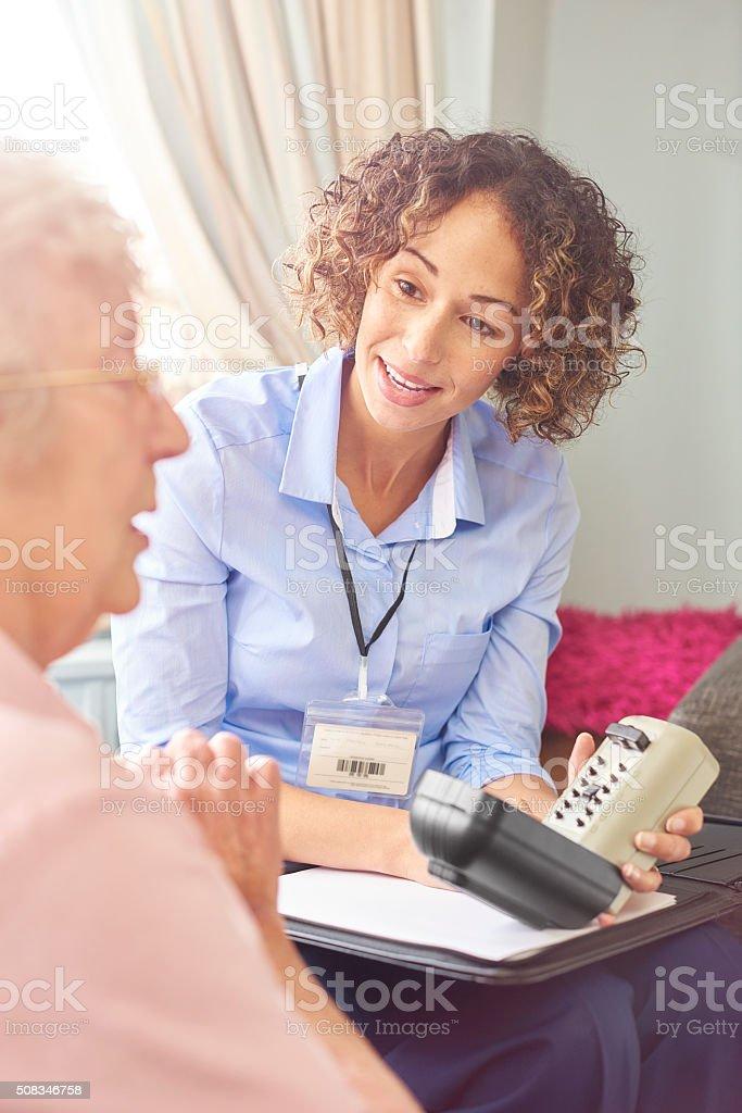 housing officer showing tenant keysafe stock photo