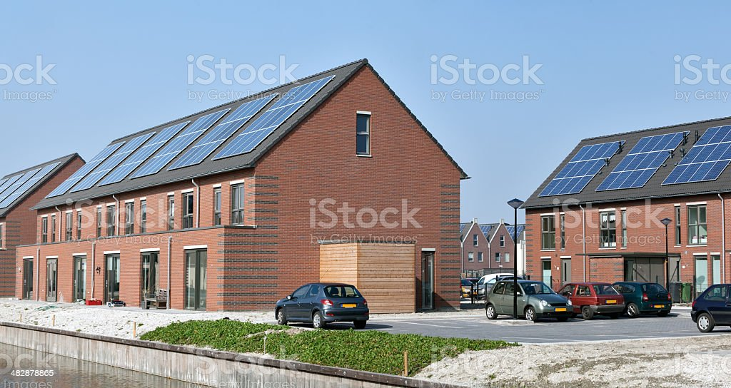 Housing project of houses with solar panels royalty-free stock photo