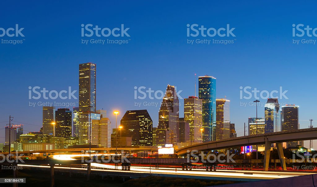 Houston downtown and highway at dusk, backlit stock photo
