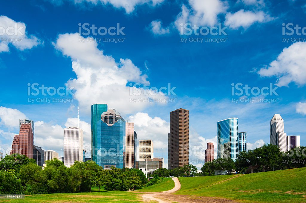 Houston downtown skyline with Buffalo Bayou Park and dramatic clouds stock photo