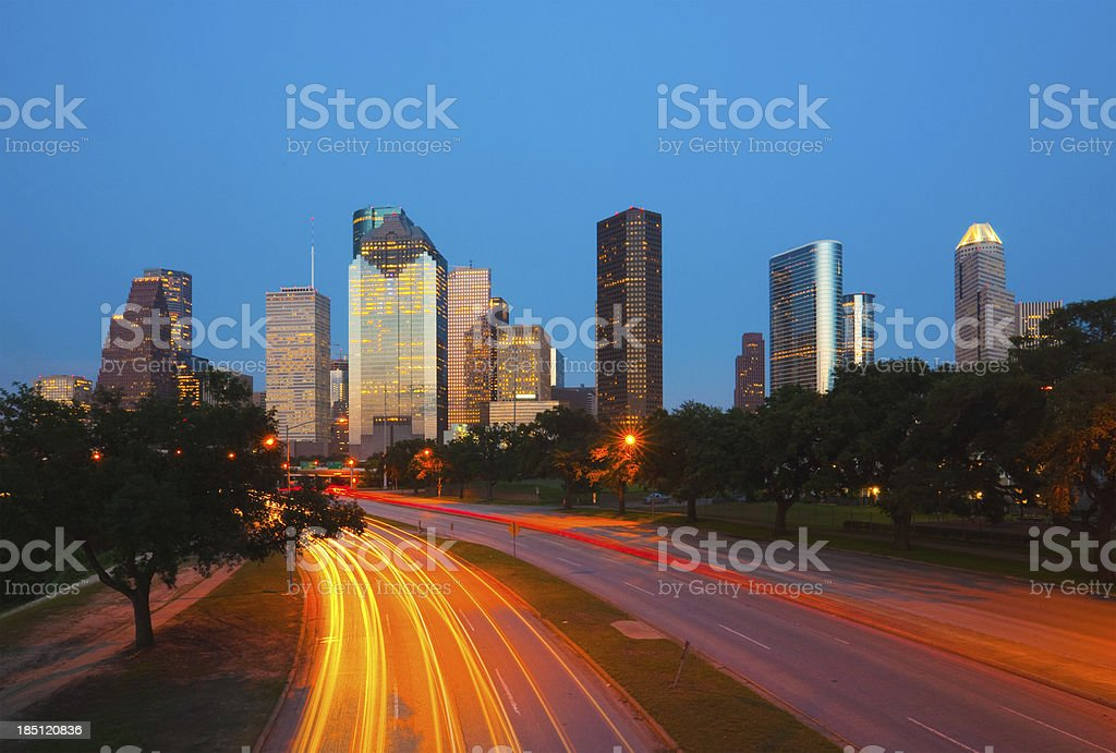 Houston skyline and light trails at dusk stock photo