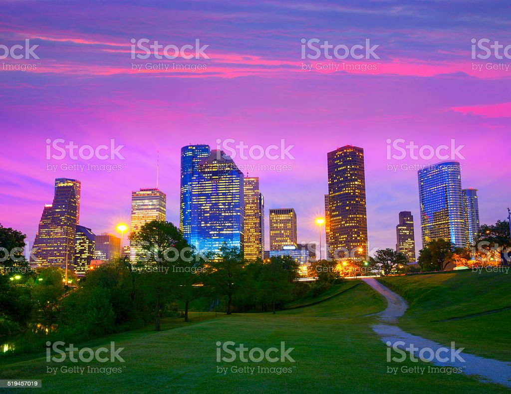 Houston Texas modern skyline at sunset twilight from park stock photo