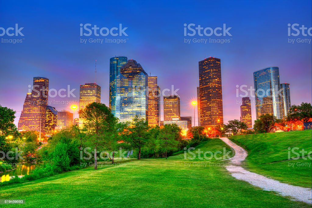 Houston Texas modern skyline at sunset twilight on park stock photo