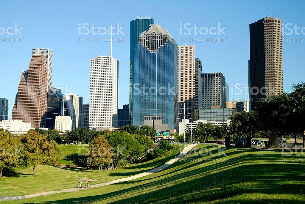 Houston, Texas Skyline Across Park with Cyclists stock photo