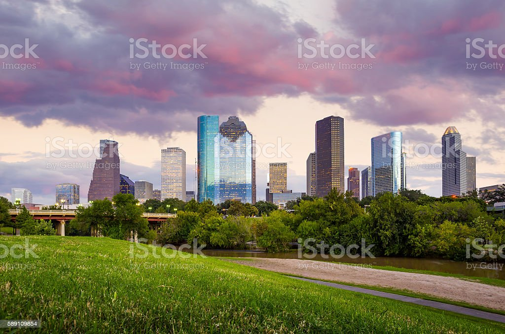 Houston Texas  skyline at sunset twilight from park lawn stock photo