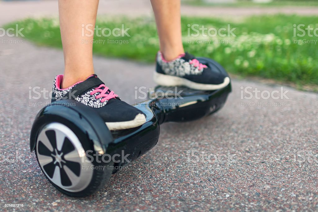 Hoverboard ride in the park stock photo