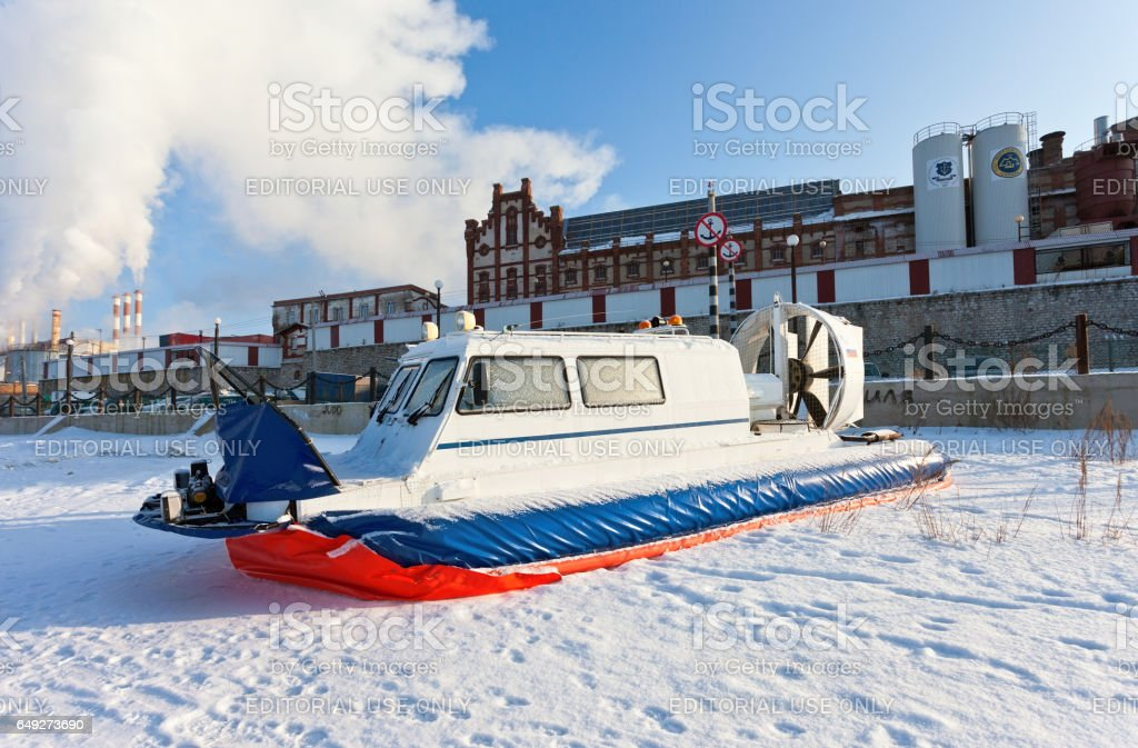 Hovercraft on the bank of a frozen river stock photo