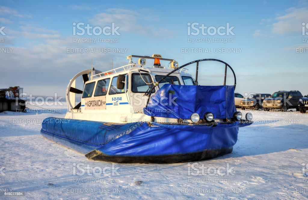 Hovercraft on the ice of the frozen river stock photo