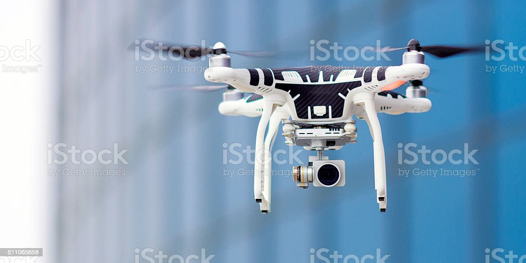 Hovering drone that takes pictures stock photo