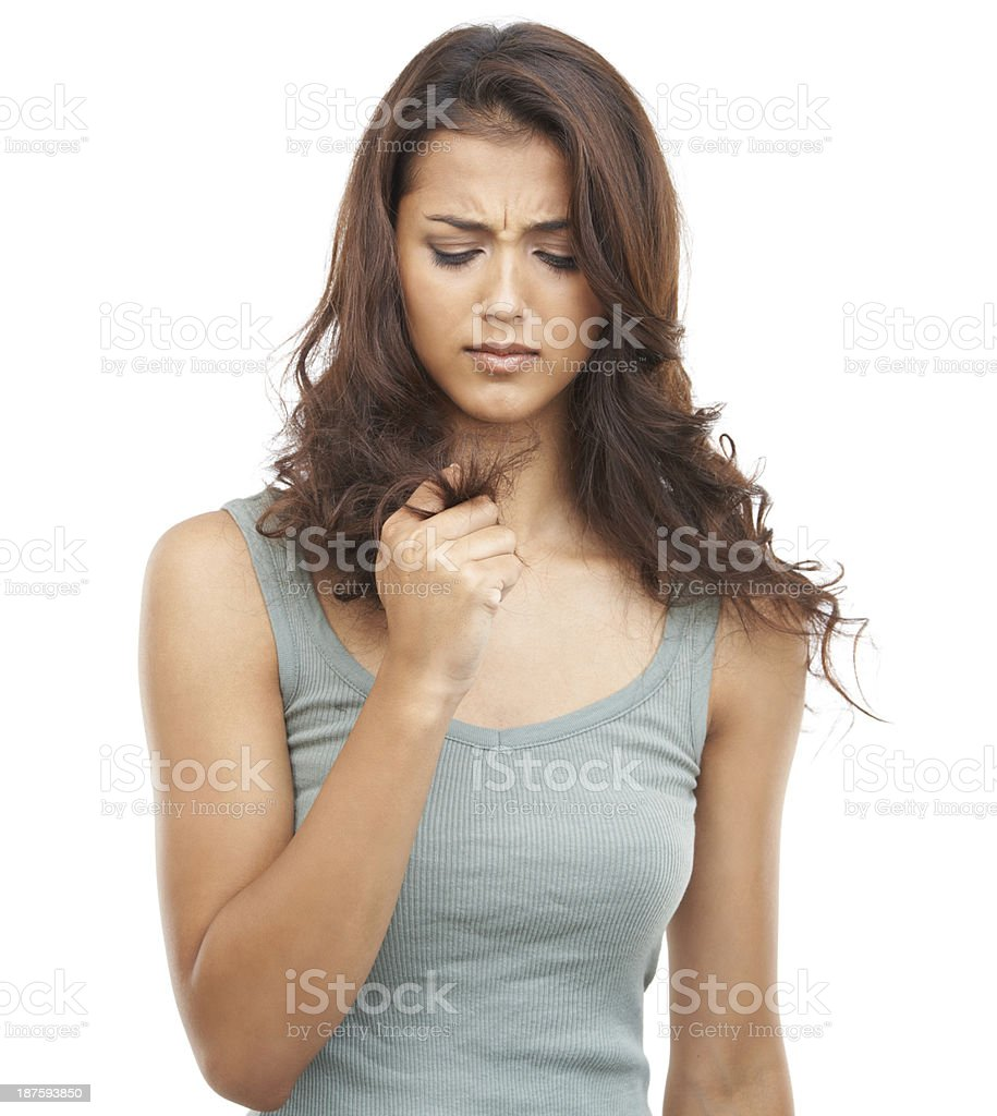 How am I going to get rid of these split-ends?! stock photo