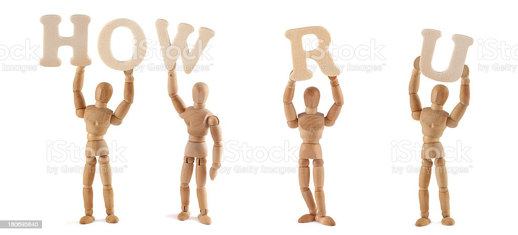 How are you - wooden mannequin holding this word stock photo