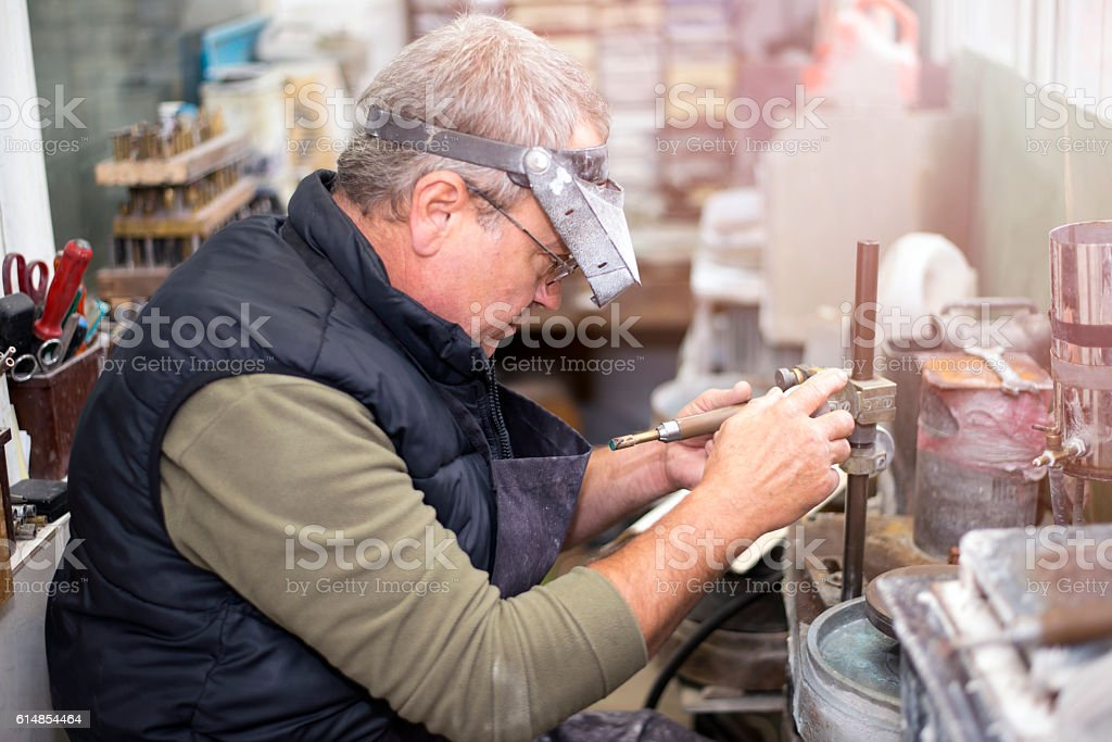 How Gems are Cut,Facete machine,gemstone grinding stock photo