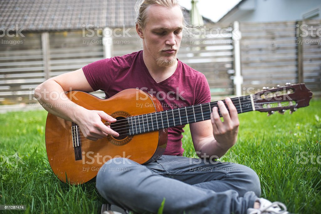 How to be a Guitarist stock photo