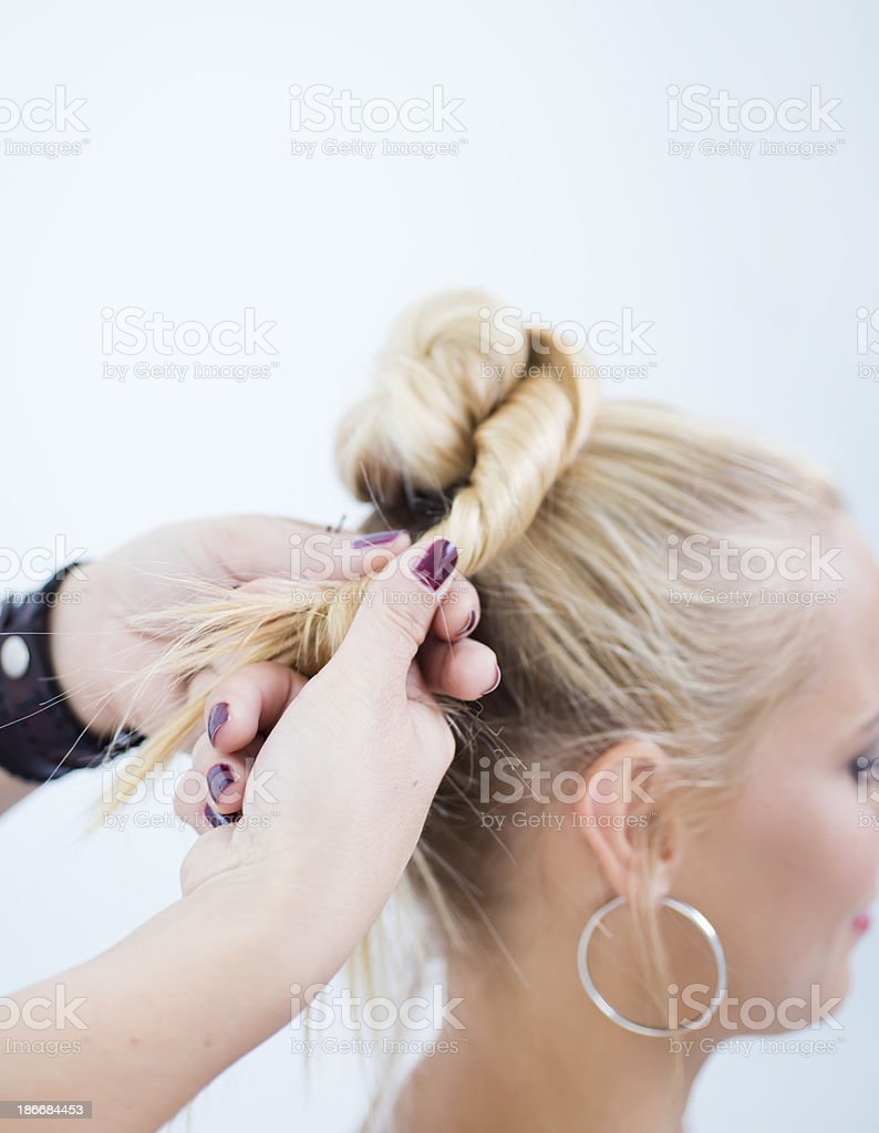 How to make a high hair bun stock photo