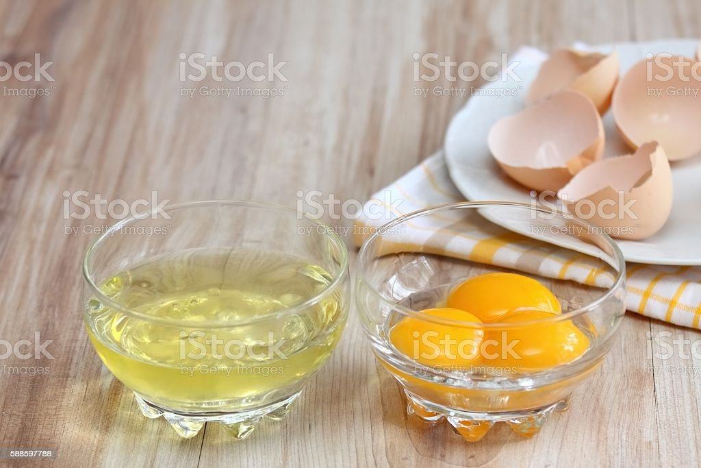 How to separate egg- white and yolk stock photo