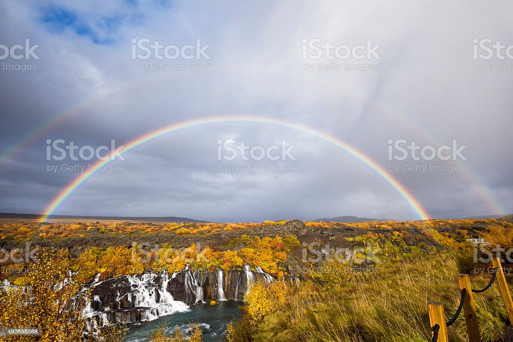 Hraunfossar Waterfalls pouring into the Hvítá river, Rainbow, West Iceland stock photo