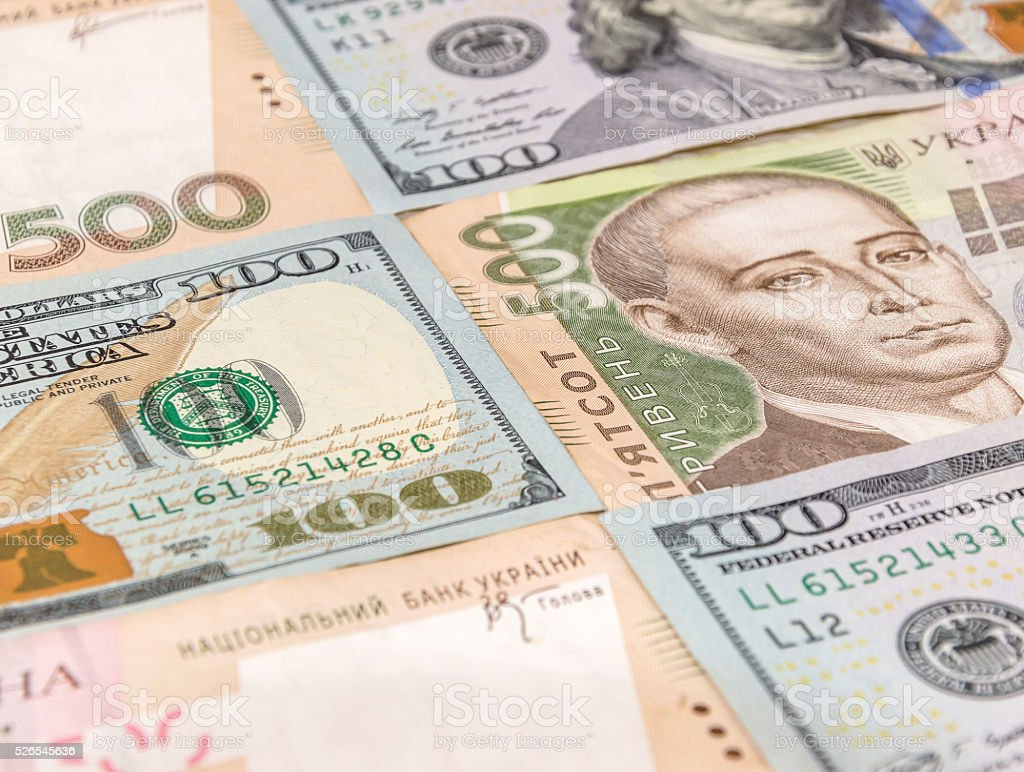 Hryvnia with dollar as background stock photo