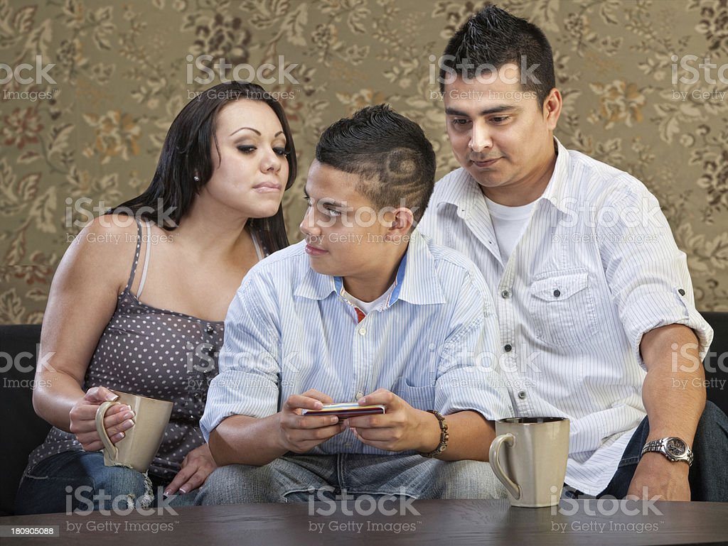 Hsiapanic Parents Watching Son royalty-free stock photo