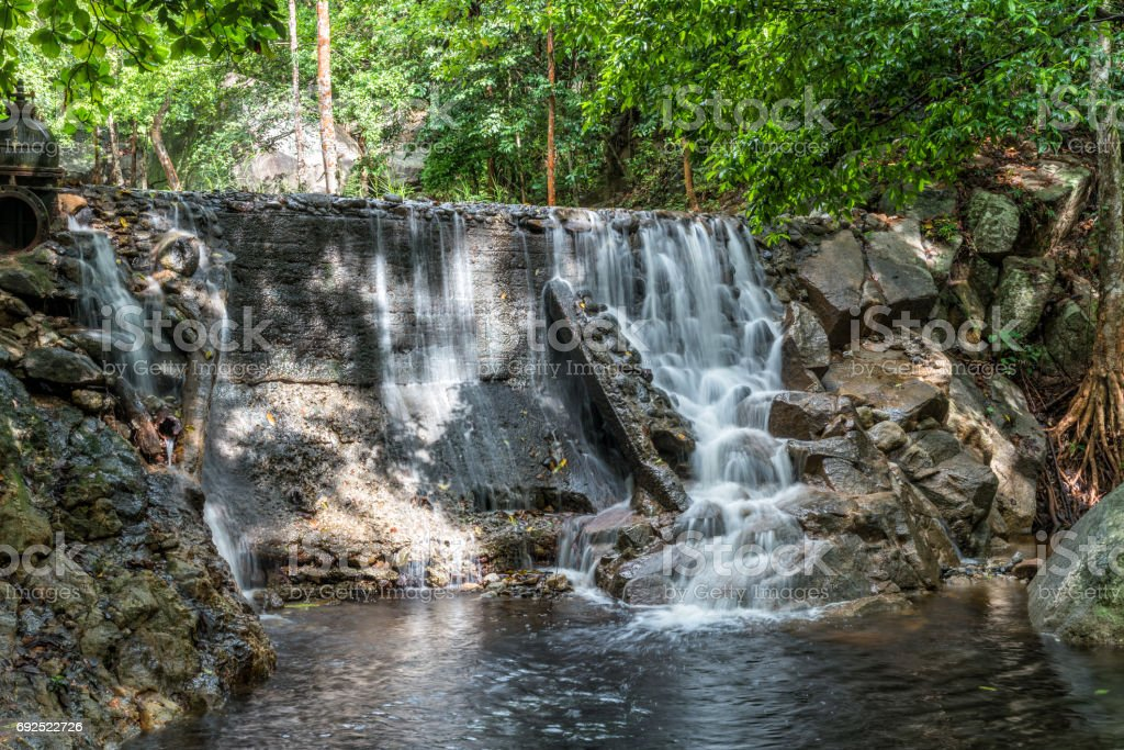 Huai Yang. Small waterfall with water motion in deep rain forest. stock photo