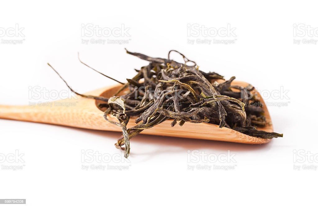 Huangshan Maofeng green tea in the wooden scoop stock photo