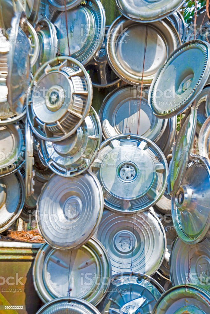 Hubcaps hung on a wall for display. stock photo