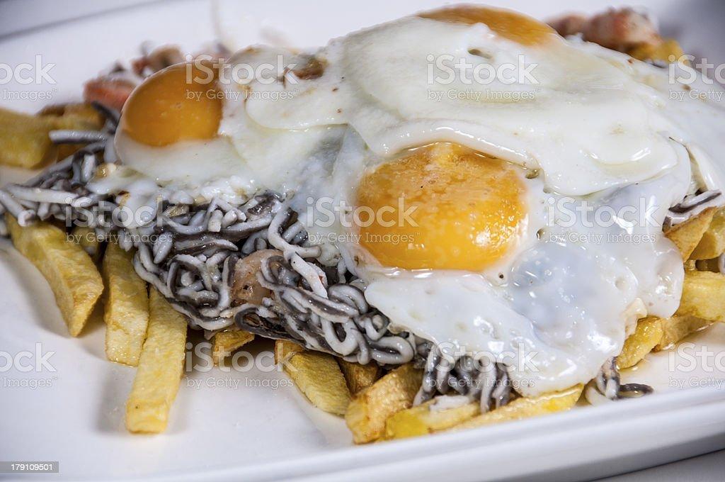 Huevos con gulas: Egss and eels royalty-free stock photo