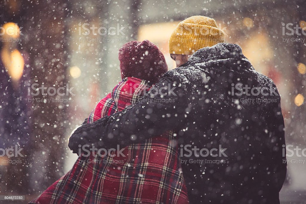 Hug in snowfall stock photo