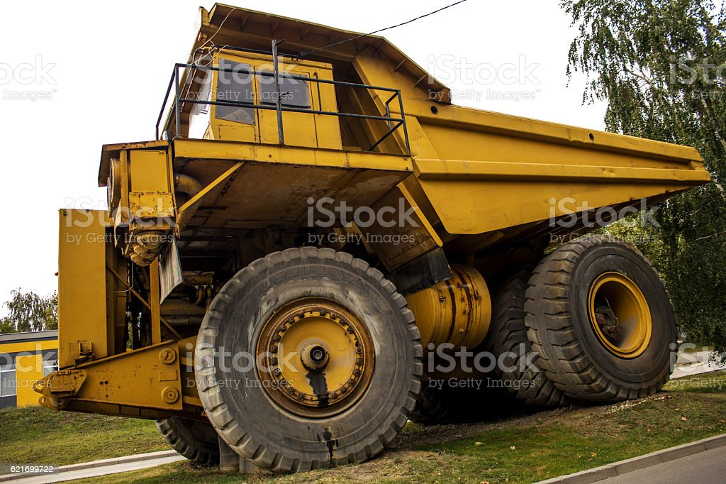 Huge auto-dump yellow mining truck. stock photo