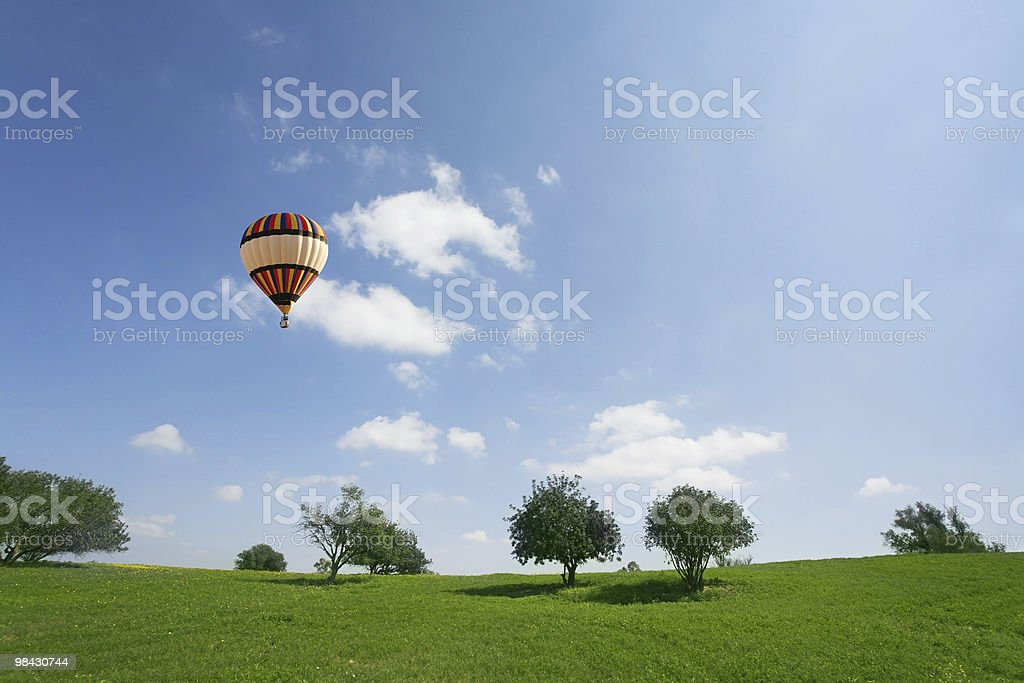 Huge balloon above meadows royalty-free stock photo