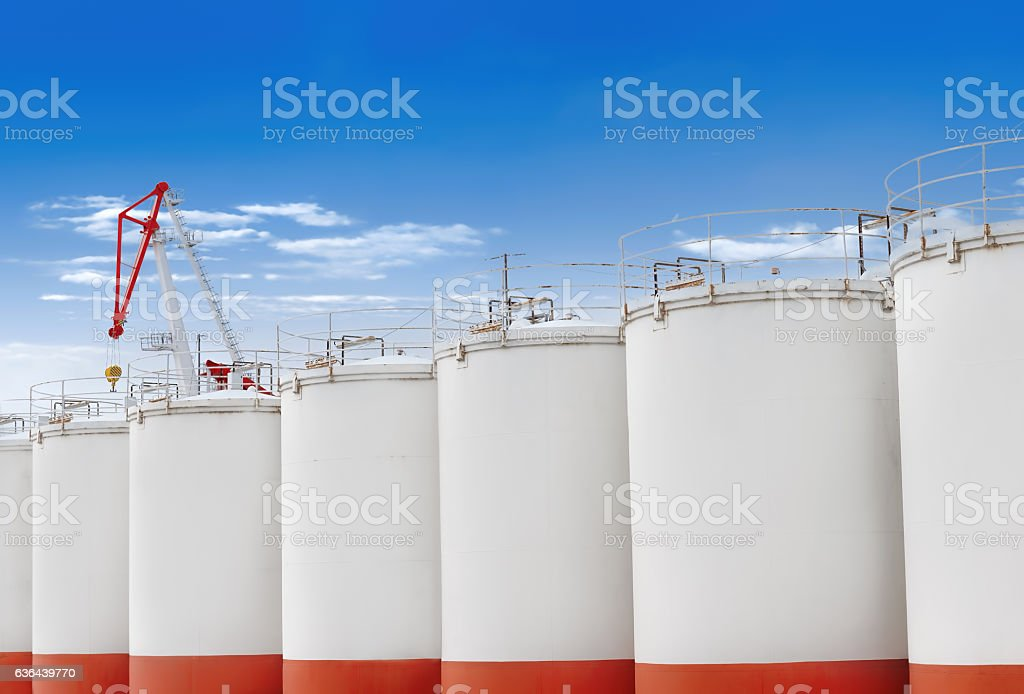 huge barrel on the background of blue sky and crane stock photo