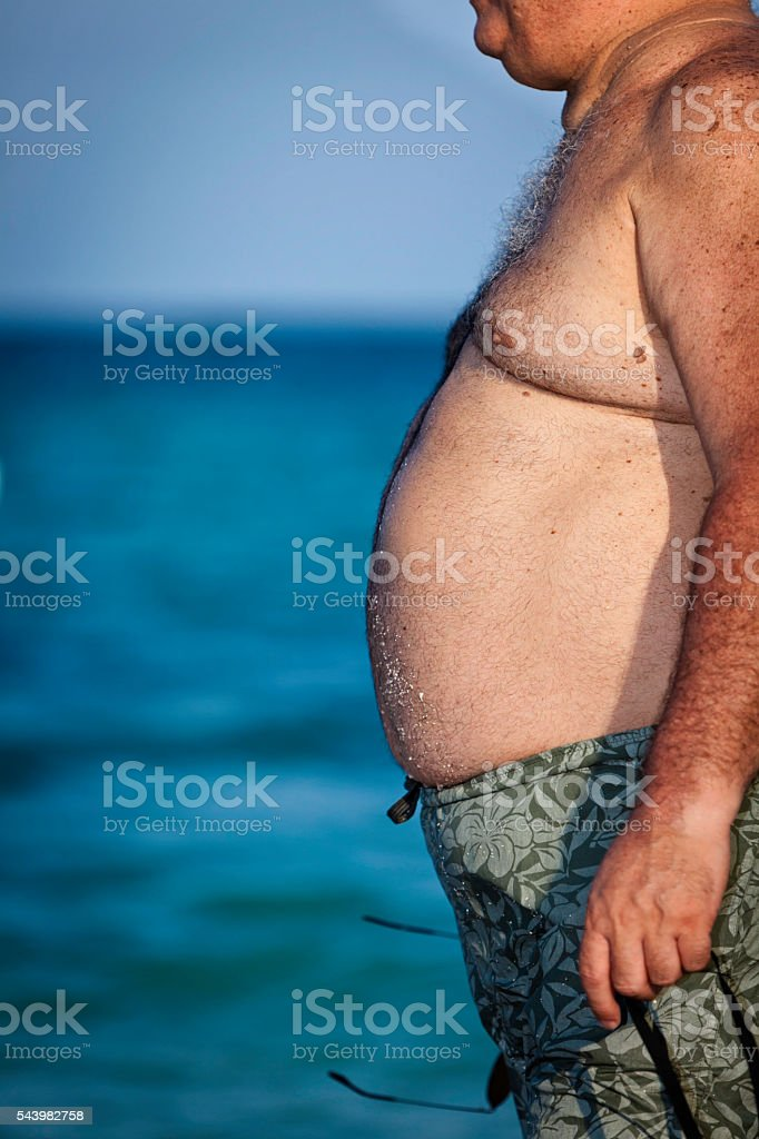 Huge belly on mature man. Obesity and health issues stock photo