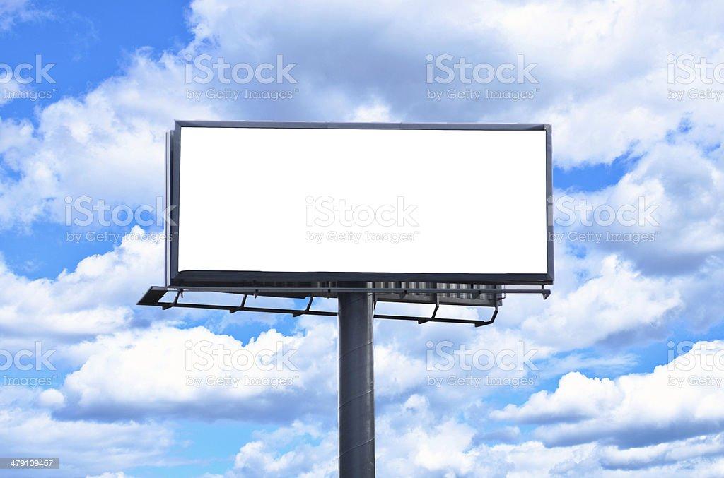 Huge blank billboard against bright blue sky stock photo