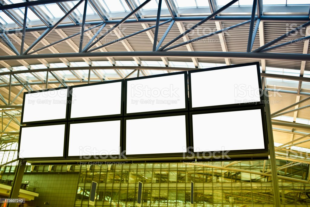huge blank screens in a modern airport stock photo