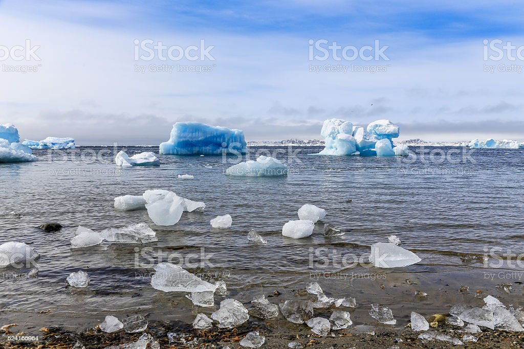 Huge blue icebergs drifting along fjord, old harbor, Nuuk, Greenland stock photo
