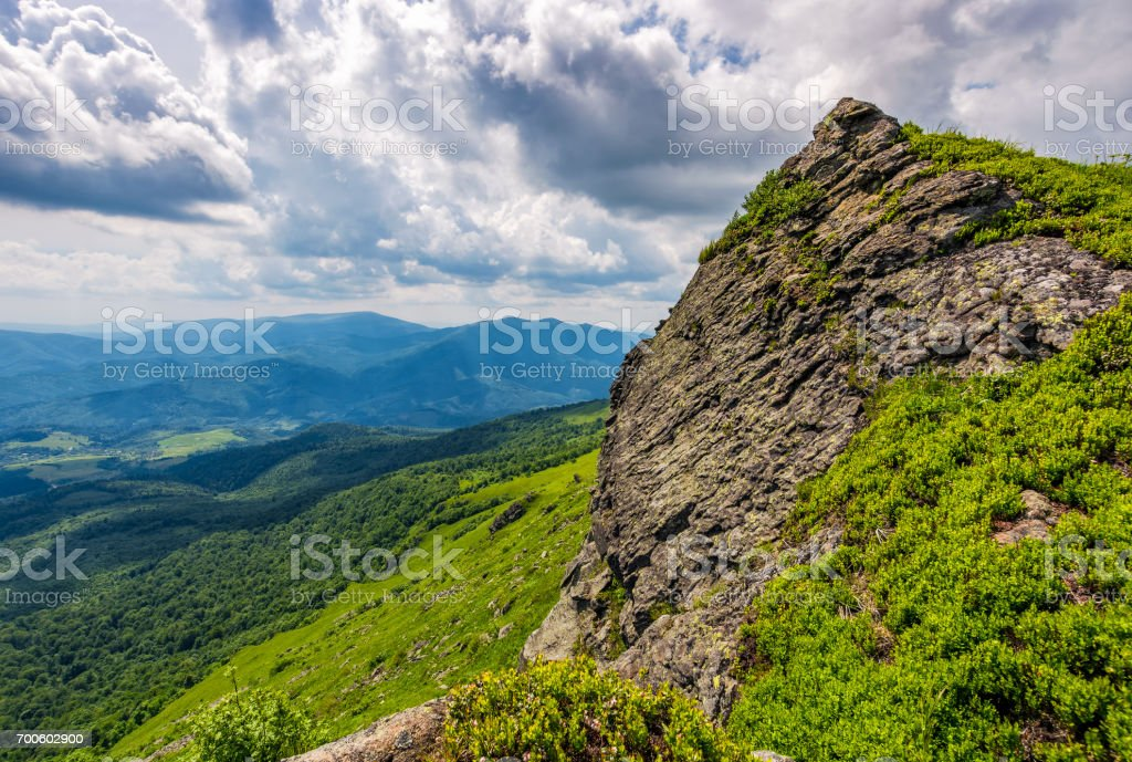 huge boulder on the edge of a hill stock photo