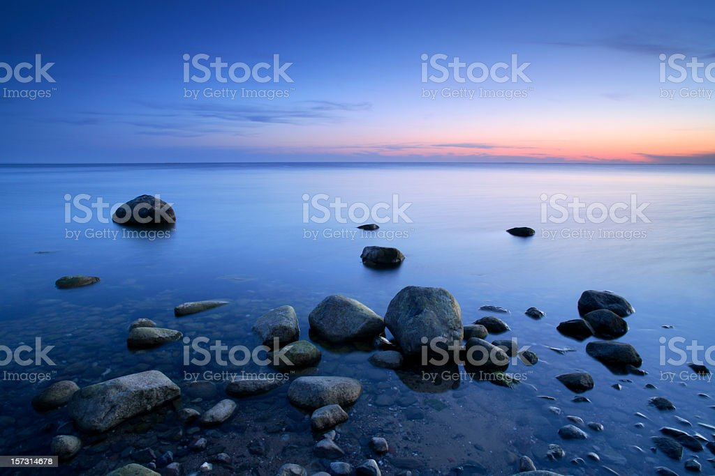Huge Boulders on Beach after sunset, Tranquil Seascape, Zen-like royalty-free stock photo