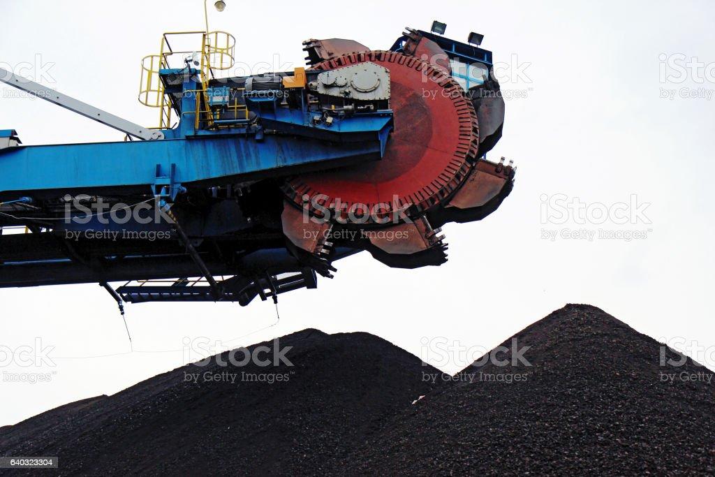 huge bucket wheel excavator in brown coal mine stock photo