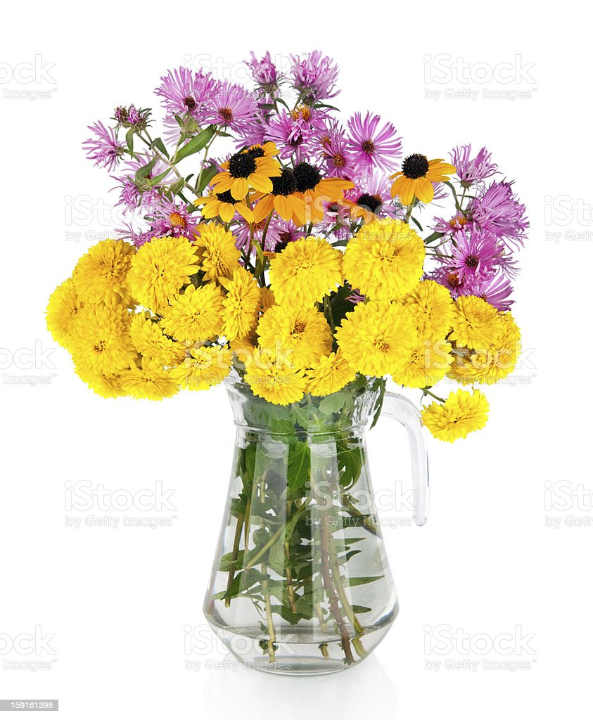 Huge bunch of white and yellow autumn flowers in vase royalty-free stock photo
