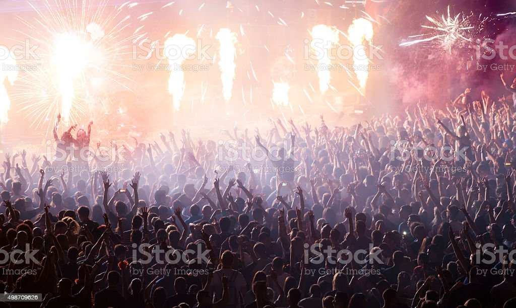 Huge cheering crowd at concert stock photo