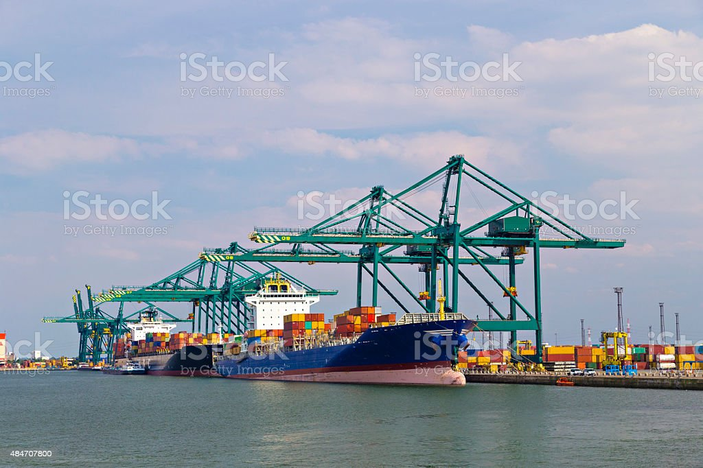 Huge container ship loaded with cranes in Antwerp container term stock photo