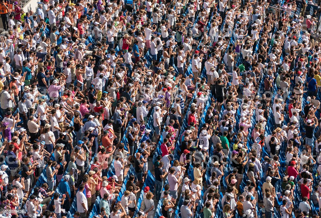 Huge crowd of spectators at a soccer stadium stock photo