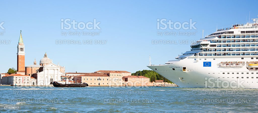 Huge cruise ship & tugboat in Venice Italy royalty-free stock photo
