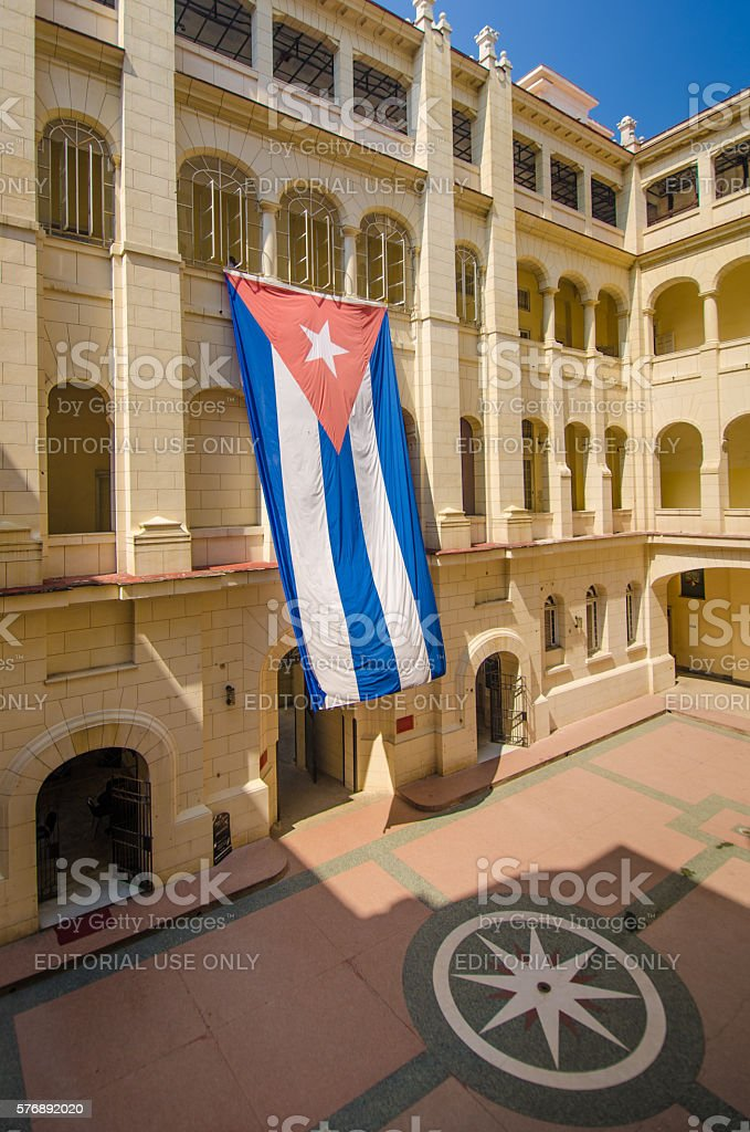 Huge Cuban flag in courtyard of Revolution Museum stock photo