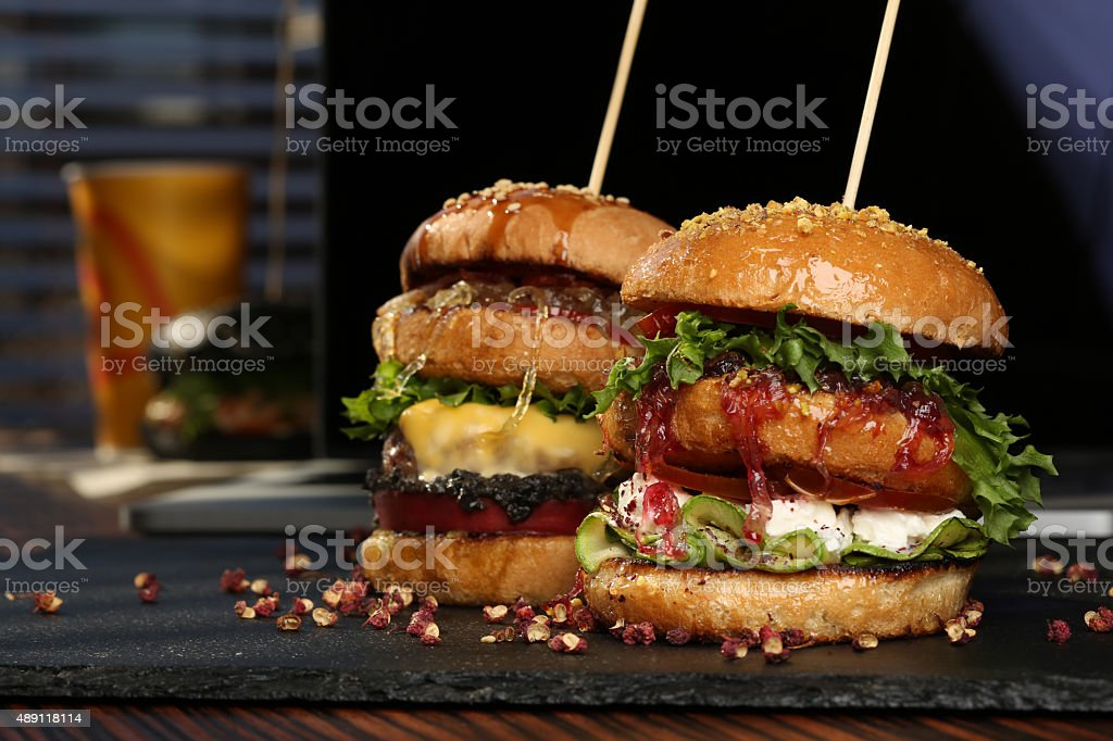 Huge Double hamburger with fresh grilled beef isolated on a stock photo
